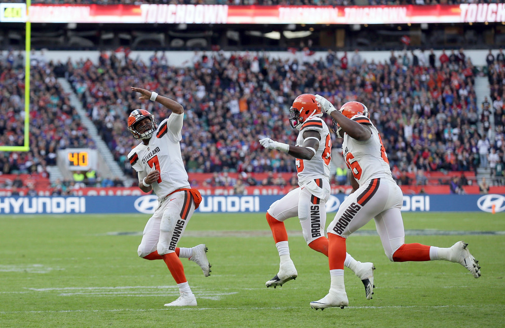 . Cleveland Browns quarterback DeShone Kizer (7) celebrates with teammates after scoring on a 1-yard touchdown run during the first half of an NFL football game against the Minnesota Vikings at Twickenham Stadium in London, Sunday Oct. 29, 2017. (AP Photo/Tim Ireland)