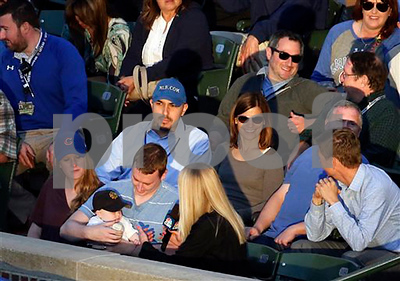 fan-makes-great-catch-over-tarp-while-holding-baby