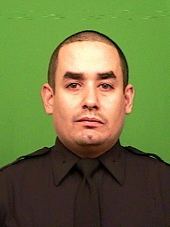 . This photo provided by the New York Police Department shows officer Rafael Ramos. Ramos and officer Wenjian Liu where shot and killed Saturday, Dec. 20, 2014, in the Brooklyn borough of New York. The suspect, 28-year-old Ismaaiyl Brinsley, ran to a subway station and killed himself. (AP Photo/New York Police Department)