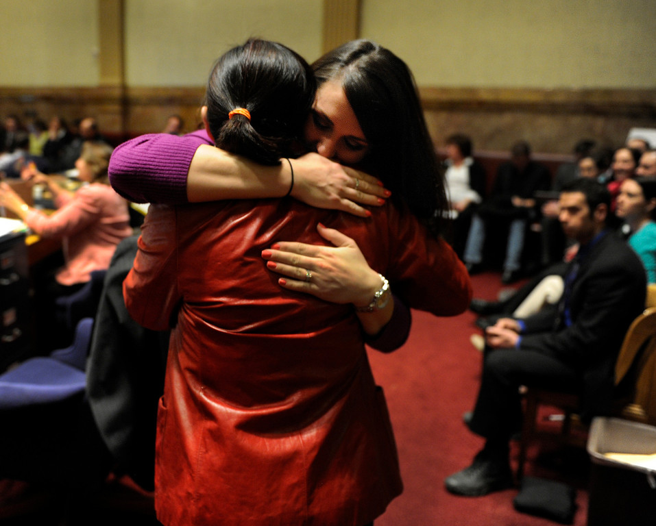 . DENVER, CO. - MARCH 8: Kimberly Weeks, right, embraced Senator Angela Giron, left, (D-Pueblo) after Senator Rollie Heath (D-Boulder) laid over his own bill concerning concealed weapons on college campuses. Weeks is a student at the University of Northern Colorado and testified against the bill earlier this week. The Colorado Senate continued to debate various gun control measures Friday night, March 8, 2013. (Photo By Karl Gehring/The Denver Post)