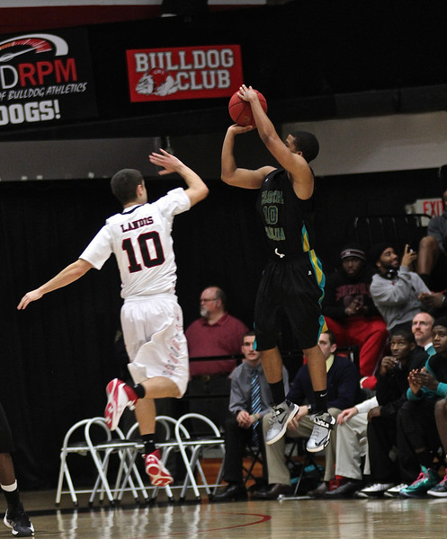 GWU Mens Basketball team defeats Coastal Carolina with less than a second on the clock and down by two points.  Final Score 66-65