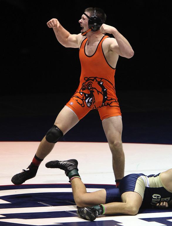. Vacaville\'s Jeramy Sweany celebrates his win against Elk Grove\'s Scott Votino in the 195-pound championship match during the California Interscholastic Federation wrestling championships in Bakersfield, Calif., on Saturday, March 2, 2013. Sweany won the match 6-1.(Anda Chu/Staff)