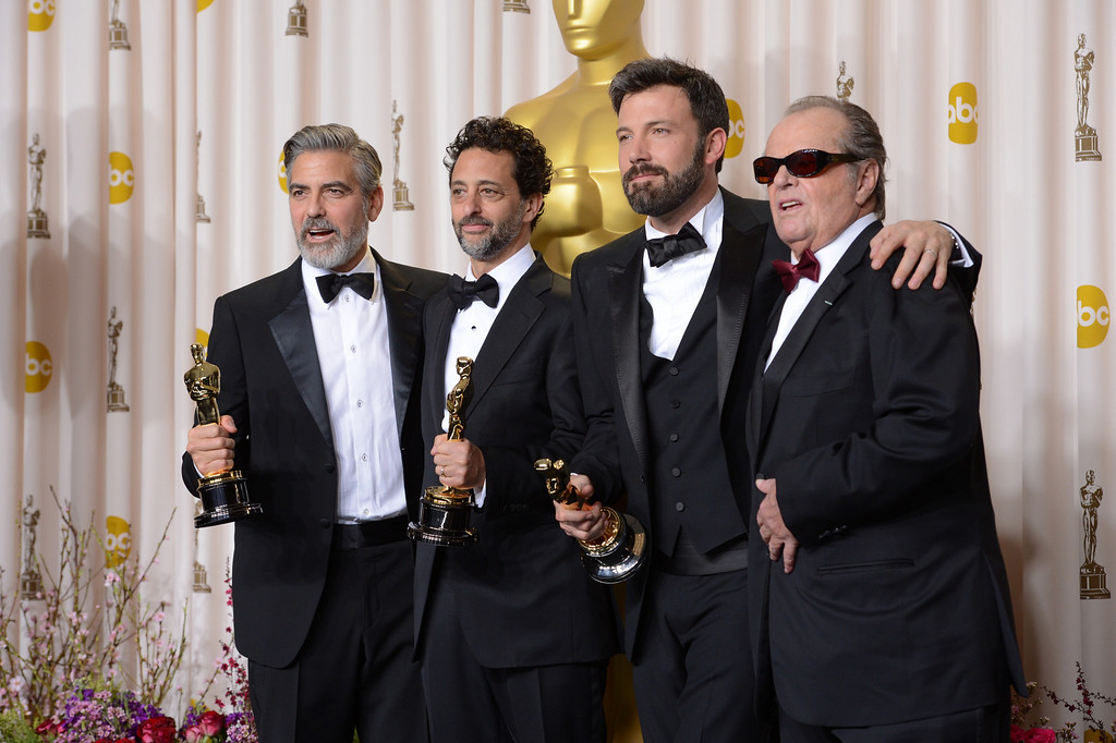 ". George Clooney, Grant Heslov, and Ben Affleck, accepts the award for best picture for ""Argo\""  backstage at the 85th Academy Awards at the Dolby Theatre in Los Angeles, California on Sunday Feb. 24, 2013 ( David Crane, staff photographer)"
