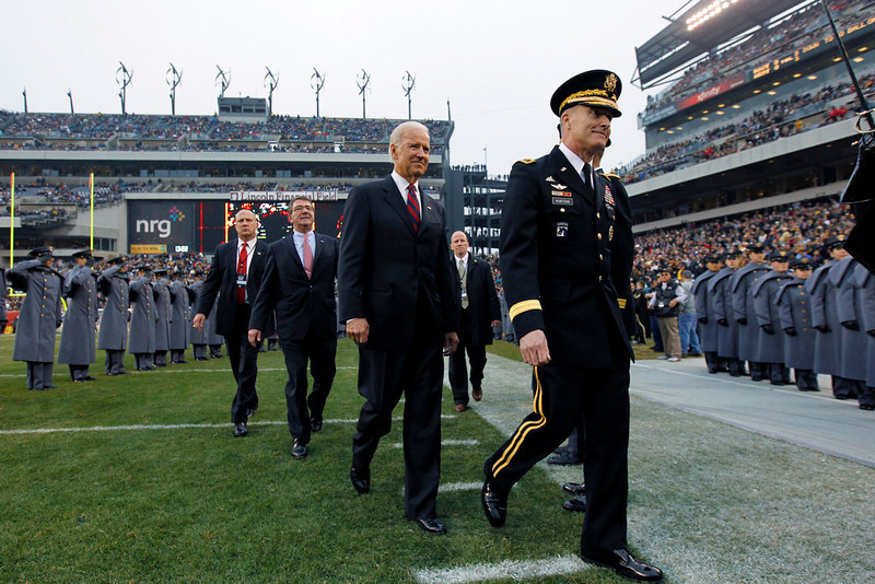 . Vice President Joe Biden walks off the field before the first half of an NCAA college football between the Army and the Navy Saturday, Dec. 8, 2012, in Philadelphia. (AP Photo/Matt Rourke)