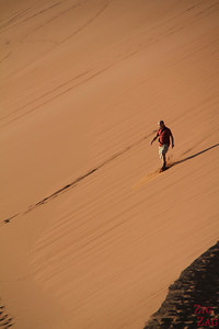 Walking down dune 45, Sossusvlei, Namibia photo 2