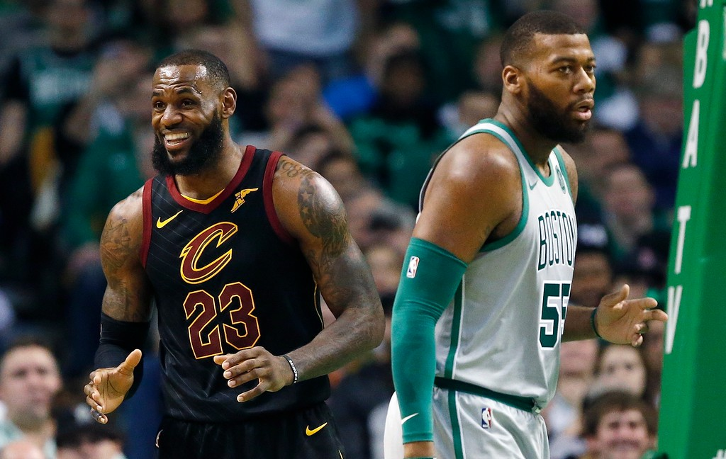 . Cleveland Cavaliers\' LeBron James (23) reacts to a call beside Boston Celtics\' Greg Monroe (55) during the second quarter of an NBA basketball game in Boston, Sunday, Feb. 11, 2018. (AP Photo/Michael Dwyer)