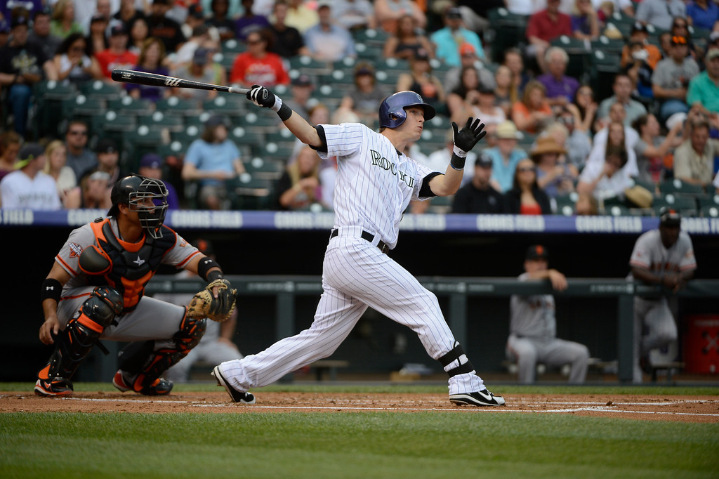 . DENVER, CO - JUNE 27: Colorado Rockies center fielder, Corey Dickerson, hits a double against the San Francisco Giants in the 1st inning at Coors Field Saturday afternoon, June 29, 2013. (Photo By Andy Cross/The Denver Post)