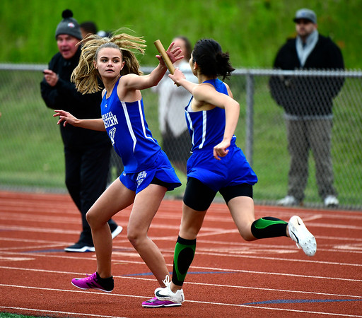 5/14/2019 Mike Orazzi | Staff Bristol Eastern girls in the 4x800 during Tuesday's city track meet at Eastern.