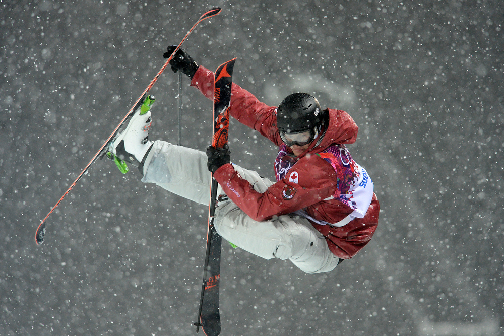 . Canada\'s Mike Riddle (silver medalist) makes a grab during the men\'s ski halfpipe final. Sochi 2014 Winter Olympics on Tuesday, February 18, 2014. (Photo by AAron Ontiveroz/The Denver Post)
