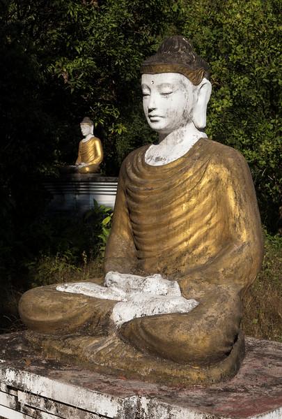 Close-up of Buddha images under Mt Zwegabin, Hpa-an, Karen (Kayin) State, Burma