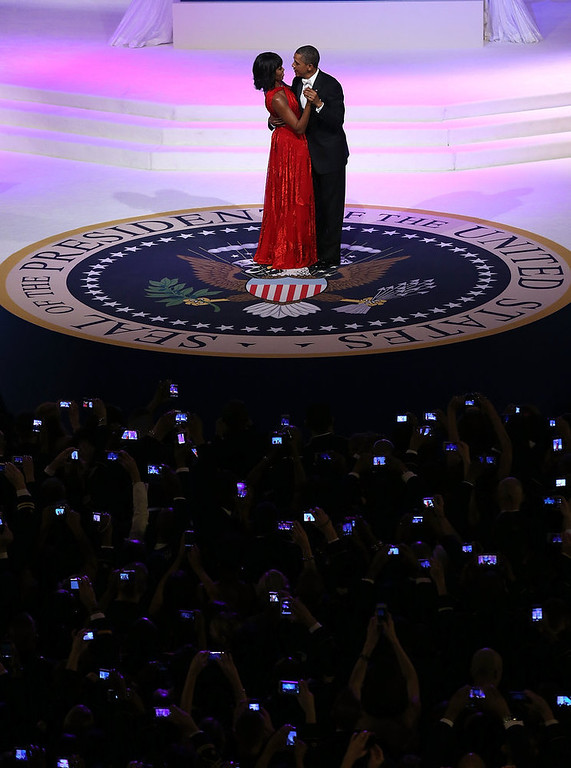 . U.S. President Barack Obama (R) dances with first lady Michelle Obama at the Commander-in-Chief Ball on January 21, 2013 in Washington, DC. Pres. Obama was sworn-in for his second term as president during a public ceremonial inauguration earlier in the day.  (Photo by Justin Sullivan/Getty Images)