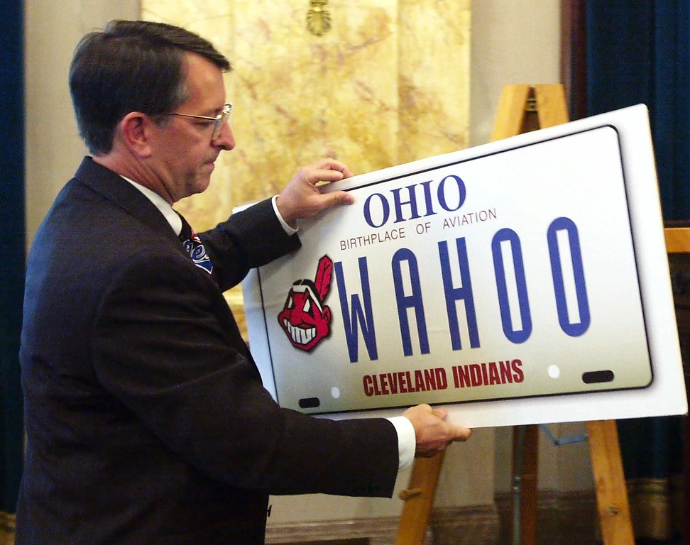 ". Sen. Bob Spada, R-Parma Heights, places an oversize version of a ""Chief Wahoo\"" license plate on an easel during a hearing of the Senate Highways and Transportation Committee at the Ohio Statehouse in Columbus, Ohio, Tuesday, Sept. 12, 2000. Spada is sponsoring a bill that would allow fans of the Cleveland Indians to purchase the license plate.  (AP Photo/Jack Kustron)"