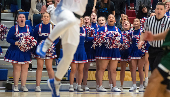 ew 03/09/20 Wesley Bunnell | StaffrrSt. Paul boys basketball vs Maloney at St. Paul Catholic High School on Monday March 9, 2020. St. Paul cheerleaders reacts during a late game play.