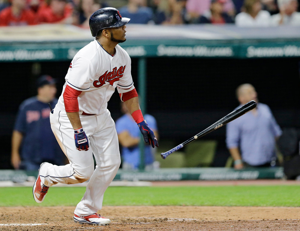 . Cleveland Indians\' Edwin Encarnacion watches his ball after hitting an RBI-single off Texas Rangers relief pitcher Dario Alvarez in the seventh inning of a baseball game, Wednesday, June 28, 2017, in Cleveland. Roberto Perez scored on the play. (AP Photo/Tony Dejak)