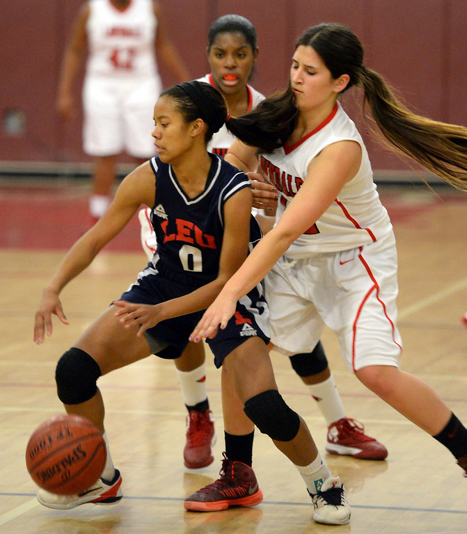. Lawndale\'s Jaynie San Miguel (12) defends against Leuzinger\'s Sydney Coleman (0) in a girls basketball game at Lawndale High Tuesday, December 10, 2013, in Lawndale, CA.  Photo by Steve McCrank/DailyBreeze