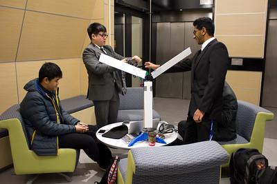 2016 - Undergraduate Engineering Students Preparing for Group Presentation in Furnas Hall Lobby