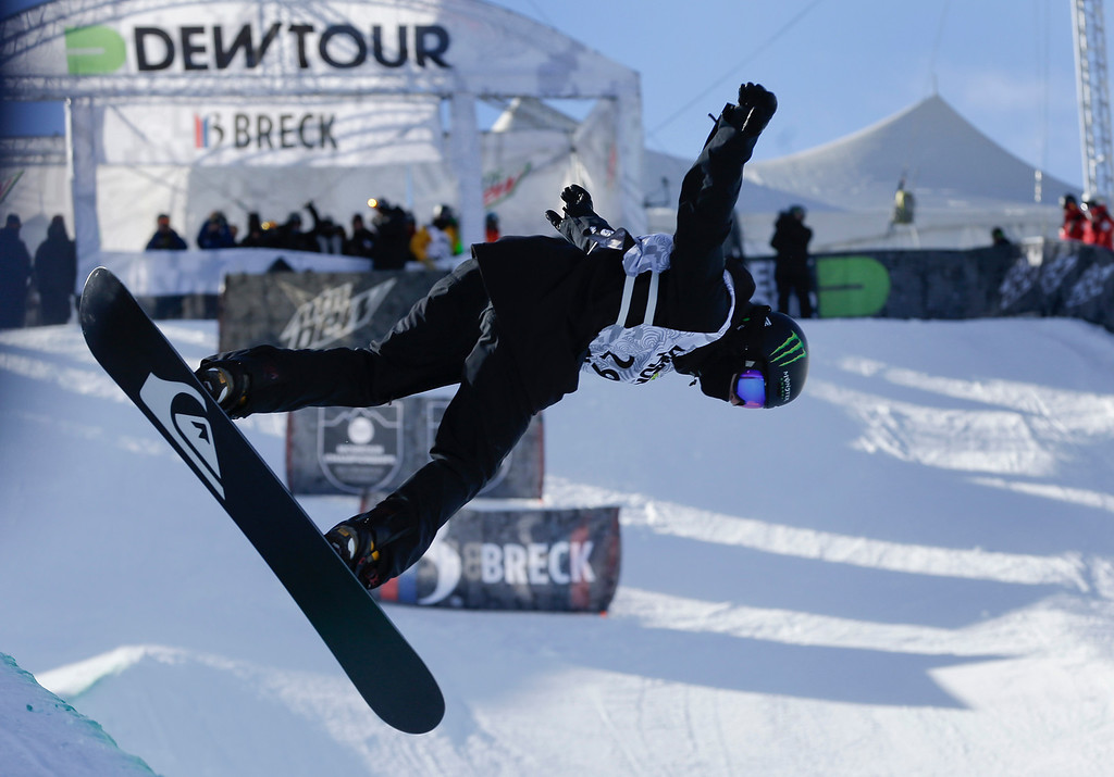 . Shaun White competes during the men\'s snowboarding superpipe final at the Dew Tour iON Mountain Championships, Saturday, Dec. 14, 2013, in Breckenridge, Colo. White placed second in the event behind Greg Bretz (AP Photo/Julie Jacobson)