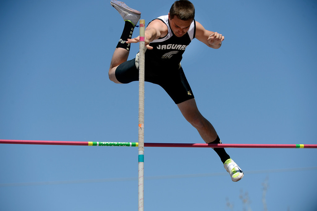 . LITTLETON, CO. - APRIL 27TH: Rock Canyon High School pole vaulter clears the bar during the Liberty Bell Track Meet at Littleton Public Schools Stadium Saturday, April 27th, 2013. (Photo By Andy Cross/The Denver Post)