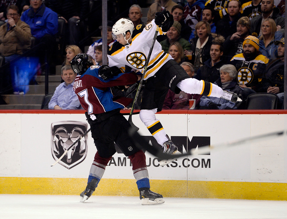 . DENVER, CO - JANUARY 21: Colorado Avalanche defenseman Brad Stuart (17) knocks Boston Bruins left wing Brad Marchand (63) up off his skates during the first period January 21, 2015 at Pepsi Center. (Photo By John Leyba/The Denver Post)