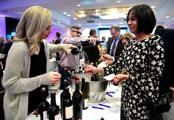 3/23/2019 Mike Orazzi | Staff Amber Frost pours wine for Doreen Radcliffe during the Bristol Hospital Development Foundation's annual Festival of Wine and Spirits held at the DoubleTree by Hilton Hotel in Bristol Saturday night.