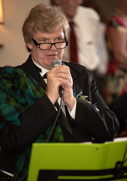 Groom singing with Lighted Glasses.jpg