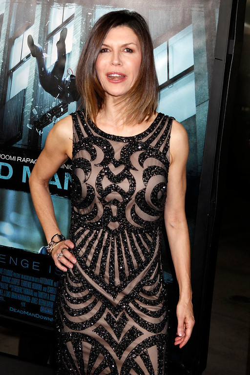 """. British actress Finola Hughes poses at the premiere of the new film \""""Dead Man  Down\"""" in Hollywood February 26, 2013. REUTERS/Fred Prouser"""