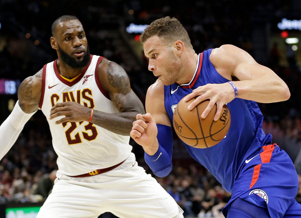 . Los Angeles Clippers\' Blake Griffin, right, drives against Cleveland Cavaliers\' LeBron James during the second half of an NBA basketball game, Friday, Nov. 17, 2017, in Cleveland. The Cavaliers won 118-113 in overtime. (AP Photo/Tony Dejak)