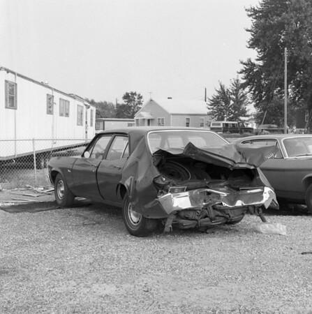 Wrecked Chevrolet Nova at Len's Gulf Service