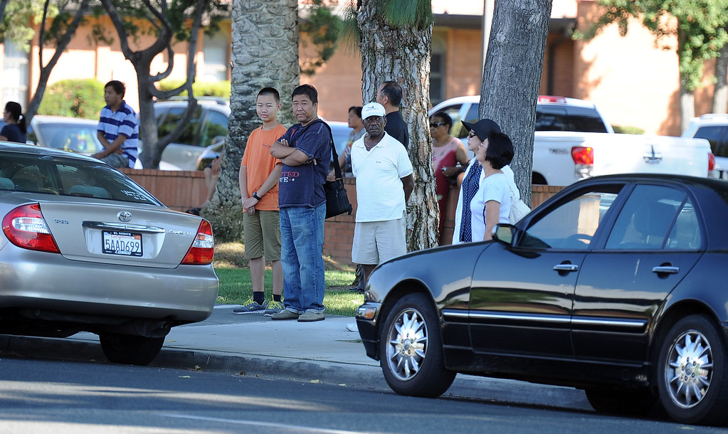 . Parents wait in a church parking lot for word on their children after a lockdown at Arcadia High School in Arcadia, Calif. on Thursday, Sept. 12, 2013.   (Photo by Keith Birmingham/Pasadena Star-News)