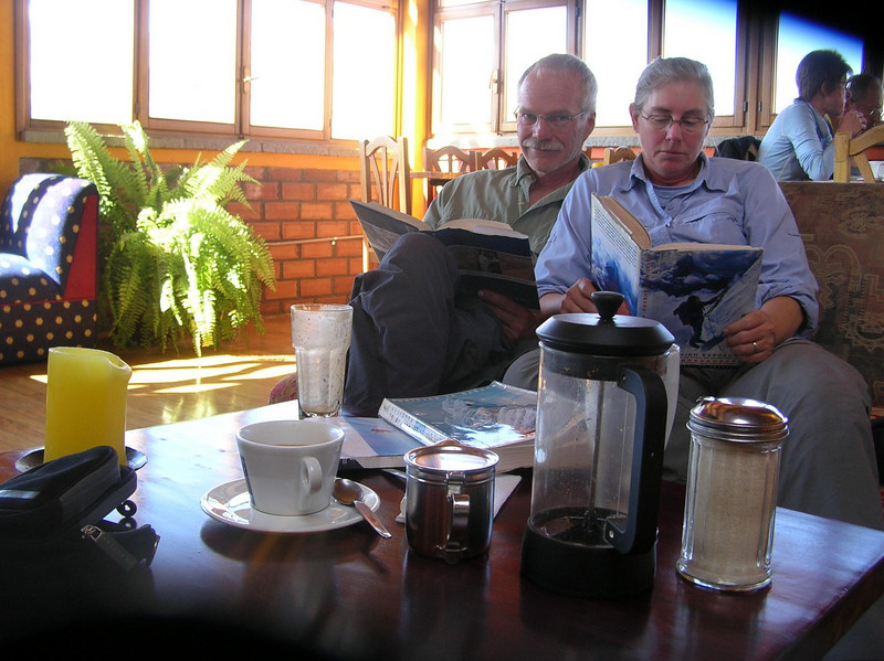 Reading books in Cafe Andino.: Cafe Andino was one of our favorite places to relax.  Great tea, mocha, hot chocolate, mango smoothies and good books make for a nice way to acclimate or recover from trekking & mountain climbing.