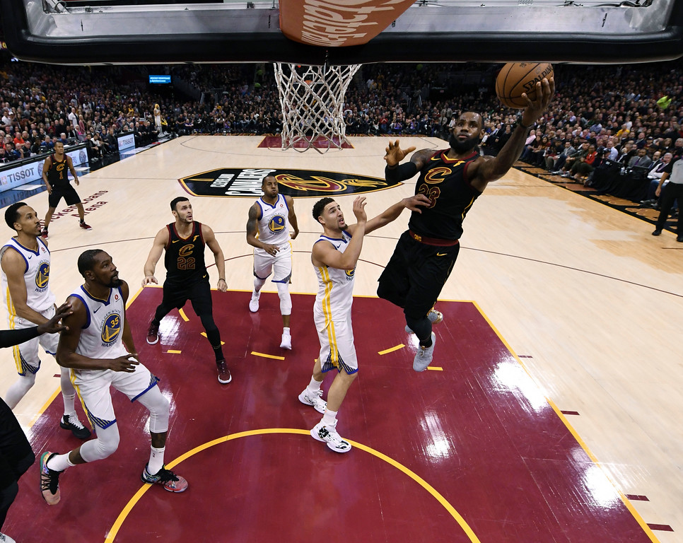 . Cleveland Cavaliers\' LeBron James puts up a shot against Golden State Warriors\' Klay Thompson during the first half of Game 3 of basketball\'s NBA Finals, Wednesday, June 6, 2018, in Cleveland. (Kyle Terada/Pool Photo via AP)