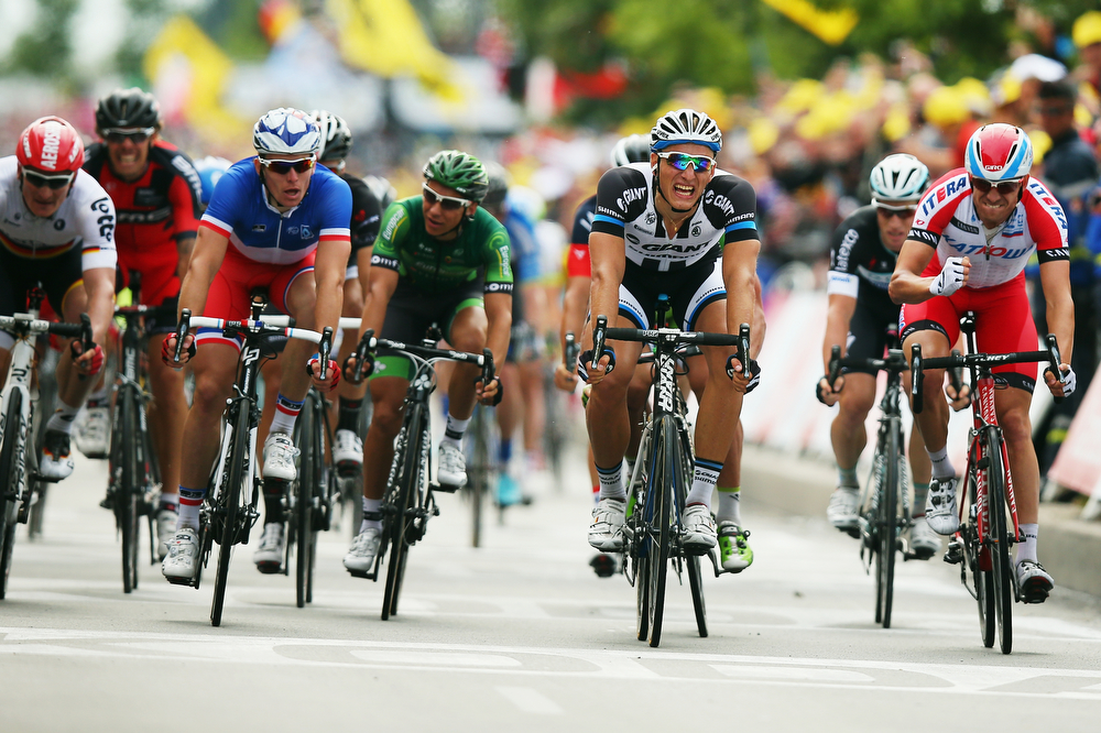 Description of . Marcel Kittel of Germany and Giant-Shimano crosses the line to win the fourth stage of the 2014 Tour de France, a 163km stage between Le Touquet-Paris-Plage and Lille, on July 8, 2014 in Lille, France.  (Photo by Bryn Lennon/Getty Images)