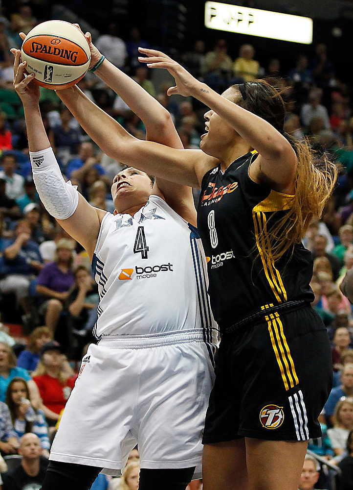 . Minnesota Lynx forward Janel McCarville (4) grabs a rebound against Tulsa Shock center Elizabeth Cambage (8) in the second half. (AP Photo/Stacy Bengs)