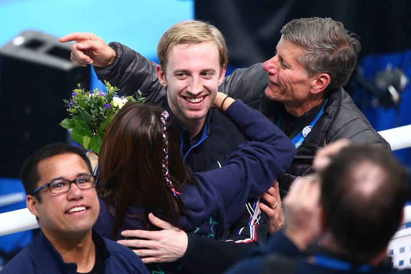 . Chris Creveling of the United States celebrates with friends and family after winning the silver medal in the Short Track Men\'s 5000m Relay on day fourteen of the 2014 Sochi Winter Olympics at Iceberg Skating Palace on February 21, 2014 in Sochi, Russia.  (Photo by Clive Mason/Getty Images)