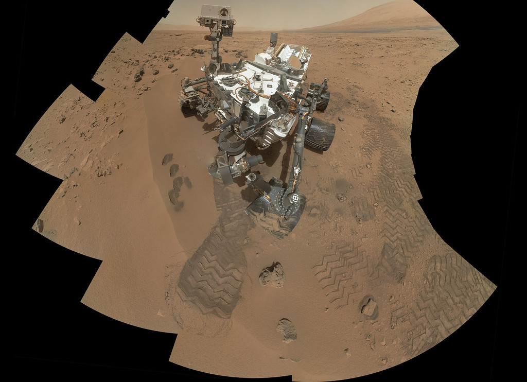 . This image released by NASA shows the work site of the NASAís rover Curiosity on Mars. Results are in from the first test of Martian soil by the rover Curiosity: So far, there is no definitive evidence that the red planet has the chemical ingredients to support life.Scientists said Monday, Dec. 3, 2012 that a scoop of sandy soil analyzed by the rover\'s chemistry lab contained water and a mix of chemicals, but not the complex carbon-based compounds considered necessary for microbial life. (AP Photo/NASA)