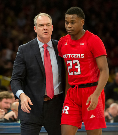 02/01/20 Wesley Bunnell | Staff Rutgers University men's head basketball coach Steve Pikiell speaks with guard Montez Mathis (23) during a game against the University of Michigan on Saturday Feb. 1, 2020.