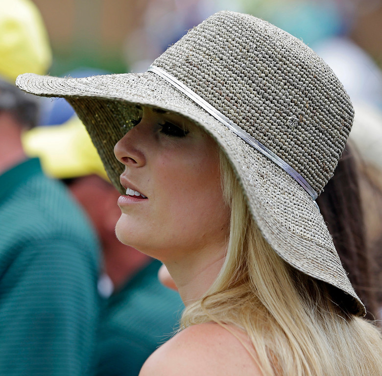 . Skier Lindsey Vonn watches Tiger Woods on the ninth hole during the first round of the Masters golf tournament Thursday, April 11, 2013, in Augusta, Ga. (AP Photo/Darron Cummings)