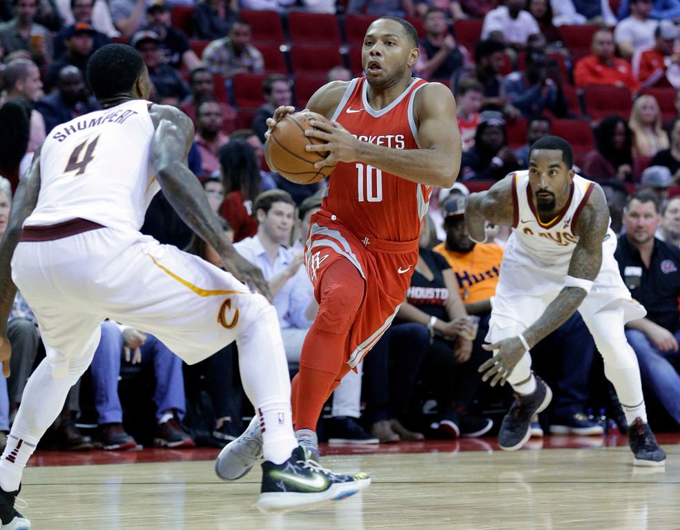 . Houston Rockets guard Eric Gordon (10) drives between Cleveland Cavaliers guards Iman Shumpert (4) and JR Smith (5) during the second half of an NBA basketball game Thursday, Nov. 9, 2017, in Houston. (AP Photo/Michael Wyke)