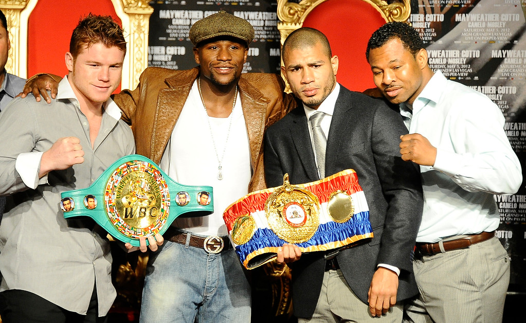 . (L-R) Pro boxers Canelo Alvarez, Floyd Mayweather Jr. Miguel Cotto and Sugar Shane Mosley pose together during a press conference at Grauman\'s Chinese Theater. They will be fighting May 5th in Las Vegas at the MGM grand hotel.Hollywood CA.  March 1,2012. Photo by Gene Blevins/LA Daily News