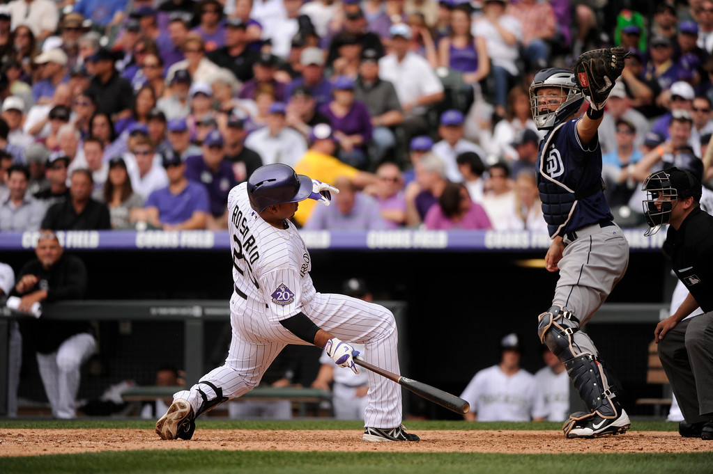 . Wilin Rosario (20) of the Colorado Rockies ducks under a high pitch in the sixth inning. (Photo by Karl Gehring/The Denver Post)