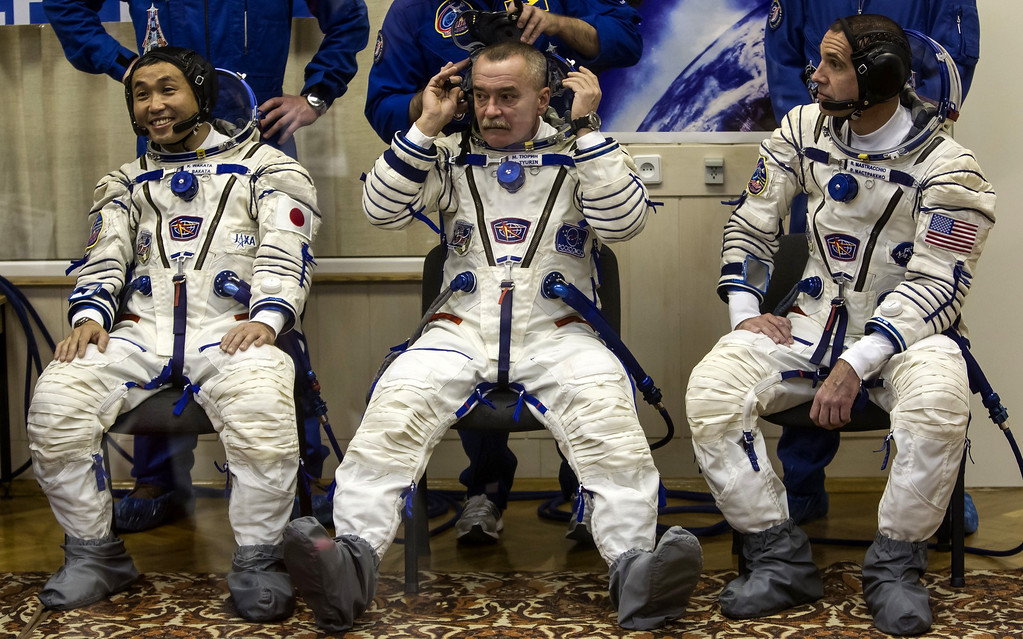 . Japanese astronaut Koichi Wakata (L), Russian cosmonaut Mikhail Tyurin (C) and US astronaut Rick Mastracchio undergo a space suit test prior to blast off to the International Space Station (ISS) from the Russian-leased Baikonur cosmodrome in Kazakhstan early on November 7, 2013. Russia on November 7 launched into space a trio of Russian, Japanese and US astronauts carrying an unlit Olympic torch that will for the first time be taken on a spacewalk to mark the 2014 Winter Games in Sochi.  AFP PHOTO/ POOL / SHAMIL  ZHUMATOV/AFP/Getty Images