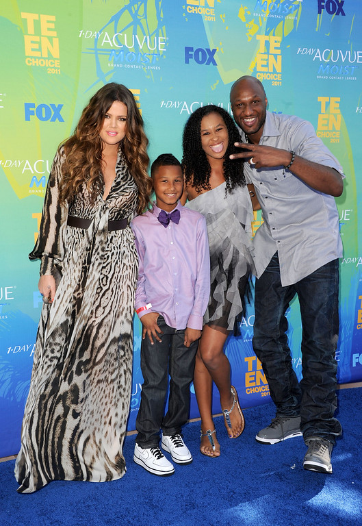 . TV personalities Khloe Kardashian, Lamar Jr., Destiny and Lamar Odom arrive at the 2011 Teen Choice Awards held at the Gibson Amphitheatre on August 7, 2011 in Universal City, California.  (Photo by Jason Merritt/Getty Images)