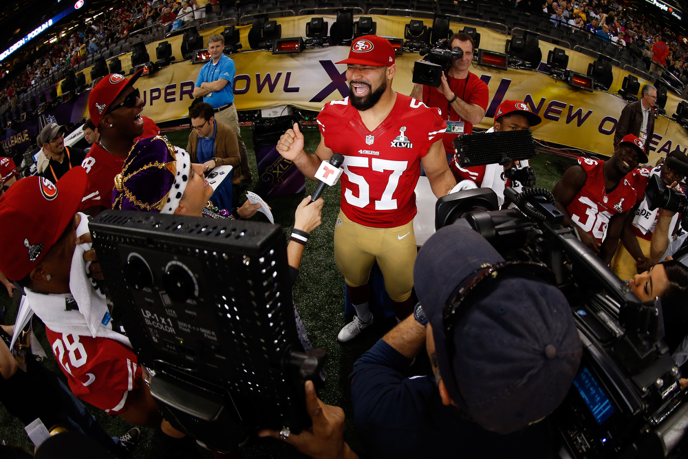 Description of . Michael Wilhoite #57 of the San Francisco 49ers yells as he answers questions from the media during Super Bowl XLVII Media Day ahead of Super Bowl XLVII at the Mercedes-Benz Superdome on January 29, 2013 in New Orleans, Louisiana. The San Francisco 49ers will take on the Baltimore Ravens on February 3, 2013 at the Mercedes-Benz Superdome.  (Photo by Chris Graythen/Getty Images)