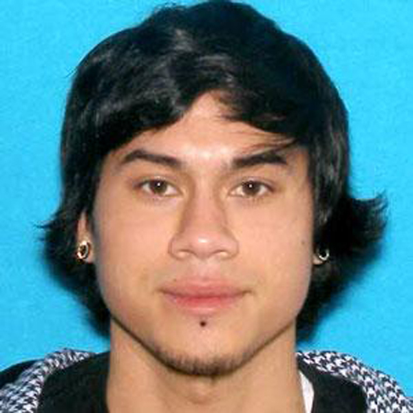Description of . This photo provided by the Clackamas County Sheriff's Department shows Jacob Tyler Roberts, the suspect in a shooting at an Oregon Mall on Tuesday Dec. 11, 2012. Roberts, who killed two people and himself in the shooting rampage, was 22 years old and used a stolen rifle from someone he knew, authorities said Wednesday. Roberts had armed himself with an AR-15 semiautomatic rifle and had several fully loaded magazines when he arrived at a Portland mall on Tuesday, said Clackamas County Sheriff Craig Roberts. (AP Photo/Clackamas County Sheriff's Department)