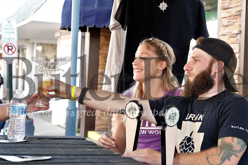 Butler Brew Works co-owner Nathan Troyan and his fiance Brittani Geibel serve up beers to festival goers at the Mars Brew Fest Saturday. Seb Foltz/Butler Eagle