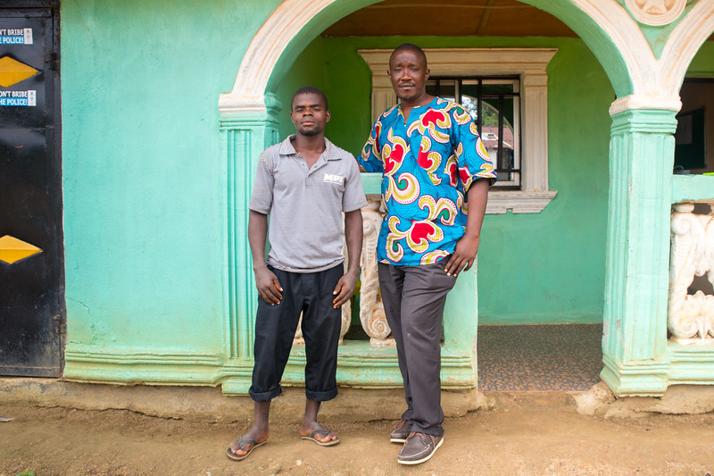 Monrovia, Liberia October 8, 2017 - Boimah Dorley (left), worked with Victor Tuazama of the Carter Center CJA to settle a debt dispute that involved police and possible jail time.