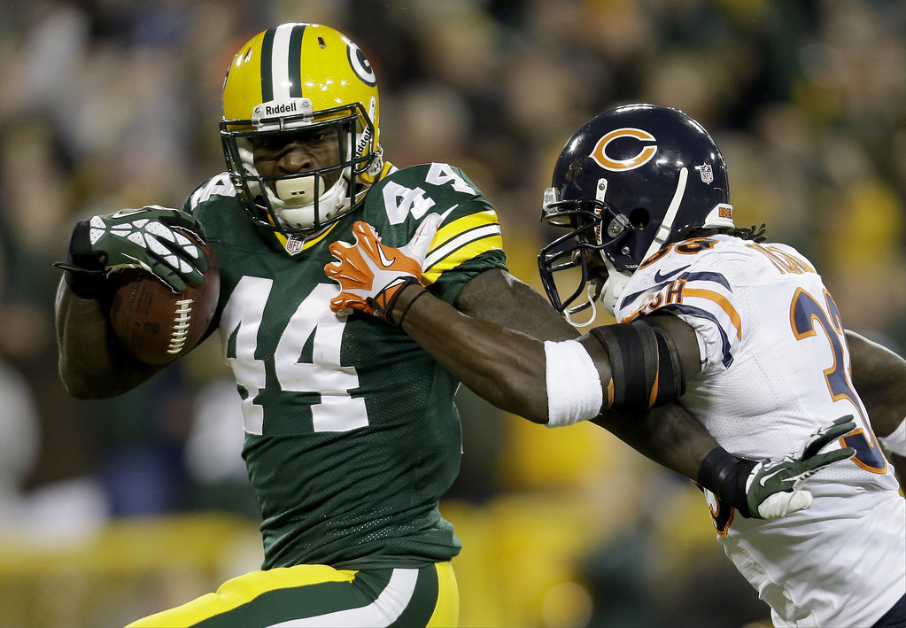 . James Starks #44 of the Green Bay Packers runs this ball in for a touchdown during the first quarter of play against the Chicago Bears at Lambeau Field on November 04, 2013 in Green Bay, Wisconsin. (Photo by Mike McGinnis/Getty Images)