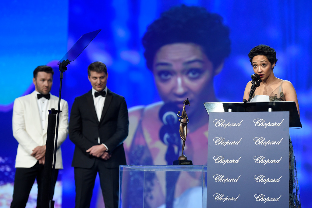 ". Ruth Negga accepts the award for rising star for ""Loving,\"" at the 28th annual Palm Springs International Film Festival Awards Gala on Monday, Jan. 2, 2017, in Palm Springs, Calif. Looking on from left are presenters Joel Edgerton, and Jeff Nichols. (Photo by Chris Pizzello/Invision/AP)"