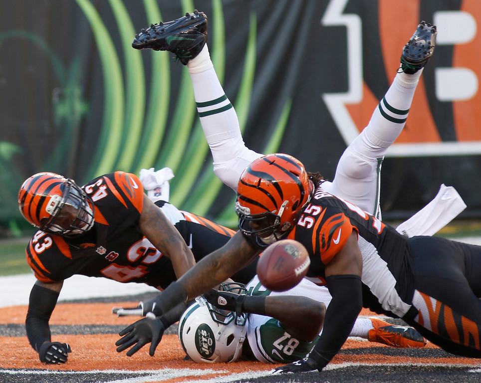 . Cincinnati Bengals outside linebacker Vontaze Burfict (55) and strong safety George Iloka (43) break up a pass intended for New York Jets tight end Jeff Cumberland (87) in the end zone in the first half of an NFL football game, Sunday, Oct. 27, 2013, in Cincinnati. (AP Photo/David Kohl)
