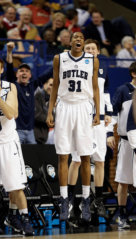 . Butler forward Kameron Woods (31) celebrates on the sideline during the second half of a second-round game in the NCAA college basketball tournament against Bucknell, Thursday, March 21, 2013, in Lexington, Ky. Butler won 68-56. (AP Photo/John Bazemore)